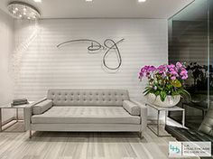 By including modern and sophisticated elements, this healthcare office design communicates the luxury of Dr. J.'s Plastic Surgery brand. The custom signage, woman's silhouette, and neutral colors bring a clean and elegant look to the space. The waiting room is often the patient's first impression of a medical office.