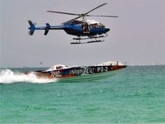 Bell Twin Turbine chases off shore powerboat