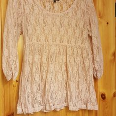 Blush colored lace top It is shorter in length but not a crop top. Looks great with a cami under. 3/4 length sleeves weavers Tops Blouses