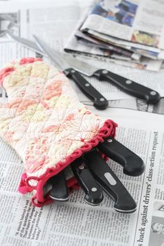 Stick your knives in an oven mitt to protect them (and you!)