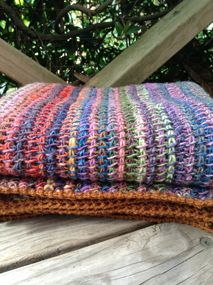 Tunisian Stashbuster Blanket made with Noro! Gorgeous!! Pattern can be purchased on StitchDivaStudios web.