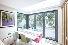 Single-Storey Extension, Loft Conversion and Refurbishment by L&E (Lofts and Extensions) in Twickenham. Don't move extend. Kitchen Extension, Dining Room Ideas, Design Ideas, Victorian Terrace Extension, Bi-Fold Doors, Multi-Coloured Kitchen Chairs, Slate Patio