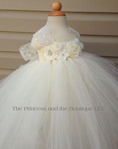ivory and white flower girl dress with a por Theprincessandthebou