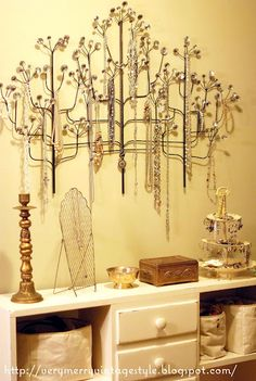 Love it... metal art used as a jewelry tree.