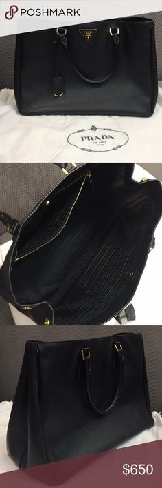 Prada top handle bag in black saffiano leather DISCONTINUED STYLE.  Original top handle Prada bag with NO zipper in middle.  Dimensions approx 14in x 10 in.  Noticeable wear and tear along bottom corners.  Great condition! Prada Bags Totes