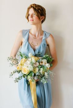 A braided crown, gorgeous bouquet by The Little Branch, and a ruffle neckline dress by Joanna August