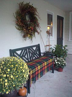 plaid.  bench.  self-fringe For Christmas add urns with greenery and red balls.
