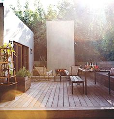 modern garden / decking space. different levels, no grass area. but needs more green and texture