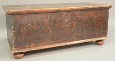 Lift top chest retaining some original tulip painting in five panels on front and painted sides, with original iron snipe hinges, probably Pennsylvania 18th century (replaced feet).  ht. 20 1/2 in.; wd. 48 1/2 in.; [...more]  Estimate: $500 - $800