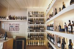 Portuguese wine shop based in the city centre of Lisbon. An independent family-run wine shop that specialises in finding the best wines Portugal has to offer. Wine Rack, Liquor Cabinet, Storage, Furniture, Home Decor, Wine, Purse Storage, Homemade Home Decor, Larger