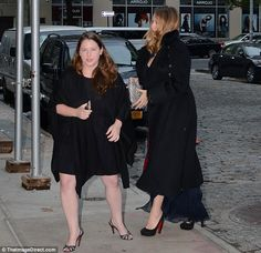 Black and blue: Blake wore a blue dress and long black coat