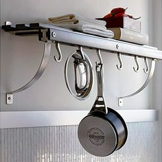 Some pots and pans are used almost daily. Hang those favorite cookware pieces from this compact wall pot rack for easy access. A convenient slatted shelf above adds storage space for smaller pans, lids, and cookbooks. Brushed nickel brackets can be installed to support the rack from above or below. Wall-mounted pot rack $100 Crate and Barrel crateandbarrel.com/