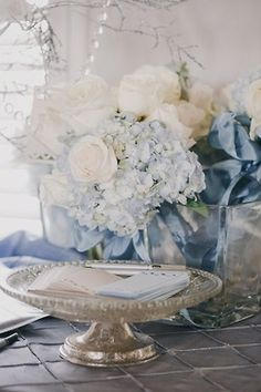 Name tags, paper hand towels, business cards, all can be offered on a pretty silver and glass compote.
