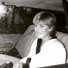 Lady Diana Spencer, fiance of Prince Charles, in the back of a car leaving her…