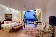 Rooms showcasing a view of the majestic Shivaliks.