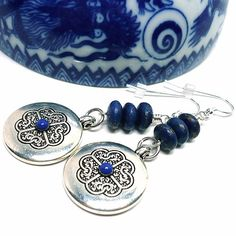 Rich and royal lapis lazuli gemstones from Afghanistan in addition to the Tibetan symbol charms makes for a powerful pair of sterling silver earrings.  Lapis Lazuli is the darkest, deepest blue with f