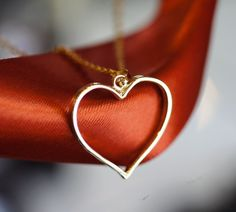 Old sentimental wedding band shaped into a heart pendant