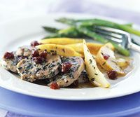 Juicy pears, dried red cherries, dry white wine,and maple syrup scented with rosemary and thyme give this tender pork tenderloin main dish recipe distinctive flavor.
