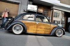 VW Beetle.. we want one of these with the wooden pannel and luggage rack & of course white walls....