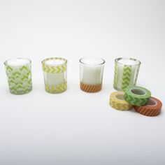 Nothing spruces up a space faster than a candle. Amp up the cute factor on your basic tealight by decorating glass votives with patterned tape and coordinate different styles to add even more pop.