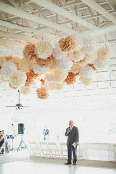 Hang a bunch of tissue pom poms - DIY with bridesmaids.  Have them hanging from the ceiling for reception. Inexpensive with a big wow factor.
