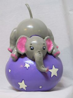 Elephant-on-a-Circus-Ball Gourd Bank made from a large bottle gourd by Gourdgeousbystacy
