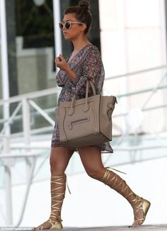 10127eedcbe0 Kourtney Kardashian shows off her slim post-baby body as she sports gold gladiator  sandals