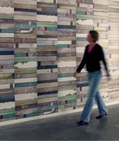 """Pallet repurposing, continued: Pallet wood used as wall covering. How-to / DIY details:Grand Design Reminds me of Piet Hein Eek's """"scrapwood wallpaper"""" (mentioned here), which is laid out vertically in a more staggered arrangement. Another reclaimed pallet wood wall application can be seen in the technology building on the Central Washington University campus (our post about it here)."""