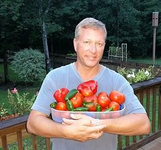"""Congratulations Scott! – The 11th WEEKLY WINNER of our 2017 PHOTO CONTEST!   """"Picture of me with one day of harvest.  Grow Boxes are amazing!  ...We love our Grow Boxes!  The fertilizer mix is definitely the best around. The ones in the Grow Boxes are already over 6 feet tall compared with the ones in the ground being less than half the size! Just amazing!""""  Send your GrowBox™ pictures to photos@agardenpatch.com for a chance to win some great prizes!"""