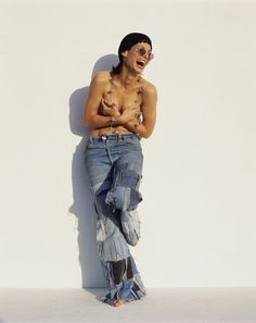 I feel sad for Sandy Bullock, who was talked into posing topless with ill-fitting patchwork jeans...