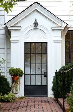Modern iron door, traditional architecture. Design by Mike Hammersmith.