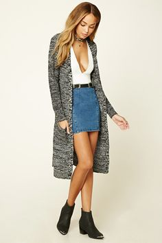 A midweight knit cardigan with a longline silhouette, an open front, long sleeves, and two front patch pockets.
