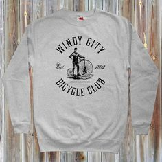 "Our vintage ""Windy City Bicycle Club"" sweatshirt for men.  Represent for Chicago, Illinois, and cycling! We designed this with an old school feel, complete with vintage cycle, Windy City Bicycle Club text, and the cycling club Chicago Barnstormers, est. 1892. Extremely soft print for a vintage look and feel. It's available in your choice of several colors."