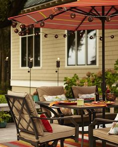 Throw some shade this spring.  An outdoor umbrella adds comfort and color to your outdoor space. Click the link in profile to shop product details. #lowes #patio #umbrella #outdoorliving