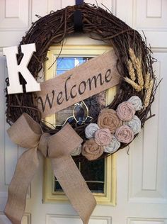 Welcome grapevine wreath with burlap rosettes and monogram. Etsy. Monogram wreath door decoration, rustic wreath, wheat wreath