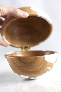 Use a hinge and attach two Blanda Matt serving bowls together to make this wooden globe . | 33 Unexpected Things You Can Make With Ikea Products