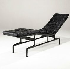 Charles and Ray Eames; Enameled Aluminum and Leather 'Billy Wilder' Chaise Longue, 1968.