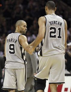 San Antonio Spurs' Tony Parker and teammate San Antonio Spurs' Tim Duncan react after Parker made two free throws against the Memphis Grizzlies late in overtime action Saturday Dec. 1, 2012 at the AT Center. The Spurs won 99-95. (Edward A. Ornelas / San Antonio Express-News) / SA