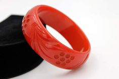 Cherry Red Bakelite Bangle  Carved and Drilled with Floral