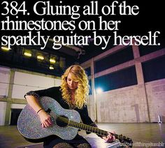 gluing all of the rhinestones on her sparkly guitar...by herself.
