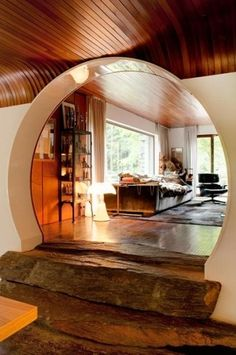 lovely interior, stone stairs, round doorway, curved wood beam ceiling.