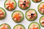 Smoked Salmon with Caviar on Cucumber - An easy-to-make cold appetizer like this one is key for cocktail parties because the elements can be made ahead, refrigerated, and put together at the last minute. Plus this simple yet sophisticated recipe is practically foolproof: Just combine the ingredients in a food processor, pipe onto English cucumber rounds, and top with your favorite caviar. It's worth spending a few dollars on a star piping tip to make the presentation extra beautiful.