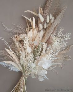 Beautiful neutral tones and varied textures make a stunning bouquet.  This is a mixture of bunny tails, pampas grass, lunaria, bleached gypsophylia (babies breath), sun palm, and meadow grass.  Find these dried plants and more in our online store.  This photo comes from @just_for_my_little_love - stunning work! DriedDecor.com  #weddingbouquet #driedplants #driedflowers #driedflowerbouquet #homedecor #naturalhomedecor #floraldesign #floralarrangement