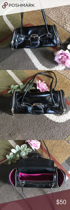"""Cole Haan bag🌸 Style is """"Alexa"""" 🌸 patent leather🌸 2 side zip pockets🌸 1 back slip pocket with magnetic closure 🌸inside 1 zip pocket🌸bag measures approx W12"""" x H 4.5"""" x D 4"""" 🌸 handle drop 9"""" 🌸 bag is black with silver hardware and pink interior Cole Haan Bags"""