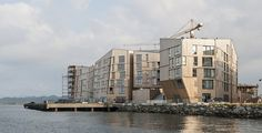"Danish architecture from AART Architects - a residential area in Stavanger, Norway. ""The Waterfront"" (Vandkanten) includes 125 flats, shops and cafes. It is praised as the largest wooden development..."