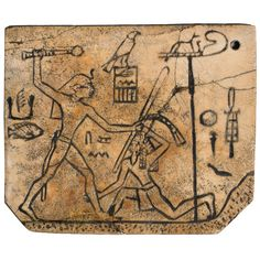King Den's sandal label. (Ancient Egyptian hieroglyphs) From Abydos, Egypt, Early Dynastic period, mid-1st Dynasty, around 2985 BC.  This example shows Den, the fifth king of the First Dynasty, about to bring his mace down on the head of his vanquished enemy. These days, parts of the ancient hieroglyphs can be seen in historical museums and ancient  Egyptian places.