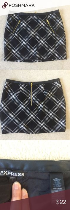 Express mini skirt w/front zip pockets Excellent condition! Front slightly longer than back.  Front length 13.5 in, back 14.5 in. Faux leather waistband.  Real front pockets!!! Express Skirts Mini