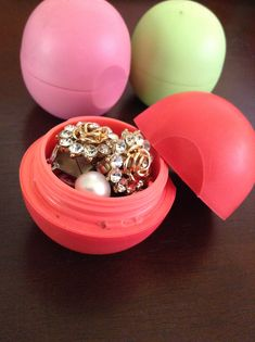 Cleaned out EOS containers are the perfect jewelry container for traveling.