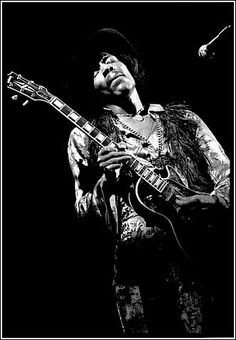 Jimi Hendrix, Fillmore East, 1969 by Elliott Landy. Band of Gypsies era, note the Gibson Les Paul.