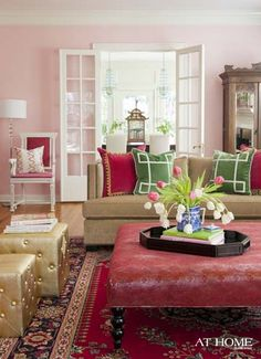 If i had a giant house i think one room might have to be pink. :)  light pink + raspberry + kelly green = Gorgeous living room by Andrea Brooks!
